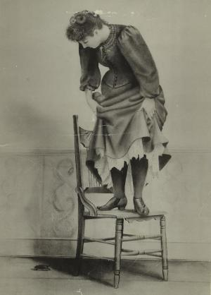 phobia treatment - woman standing on chair with mouse below
