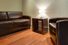 Fear and Phobia Hypnotherapy - Phobia Treatment Clinic with brown leather chairs and lamp on a side table