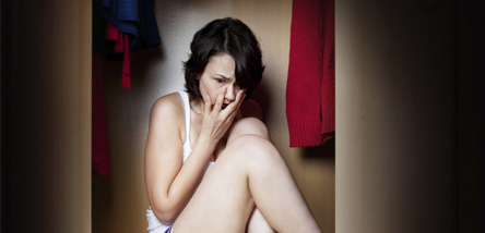 Phobia Hypnotherapy - Scared woman hiding in cupboard