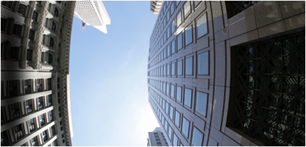 Fear of Heights Treatment - looking up from ground at tall buildings directly above with blue sky beyond