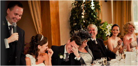 fear of public speaking hypnotherapy - successful speaker at wedding top table with people laughing