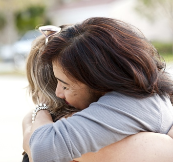 two women hug after successful phobia hypnotherapy treatment